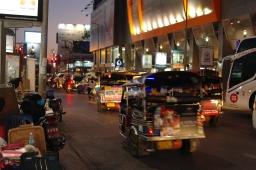 Tuk-tuks and vehicles outside Anusarn night markets