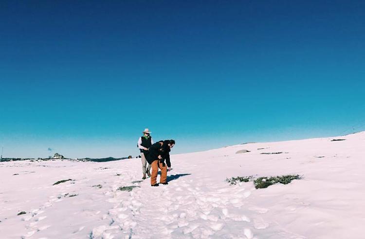 mark-and-matt-walking-through-snow-to-summit