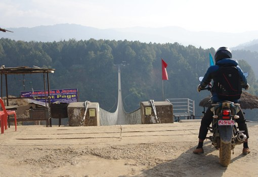 nepal-motorbike-crossing-bridge-in-kusma