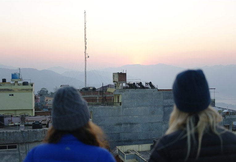 Suvini and I watch the sunrise over Tansen, Pulpa.