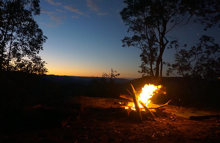 Our campfire burns as the sun sets.